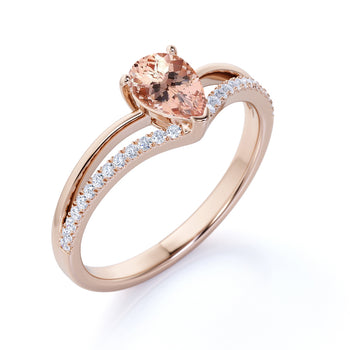1.5 Carat Pear Shaped Morganite Split-Shank Chevron Engagement Ring with Pave Diamonds in Rose Gold