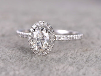 1.50 Carat Oval Cut Moissanite and Diamond Halo Engagement Ring in 9k White Gold