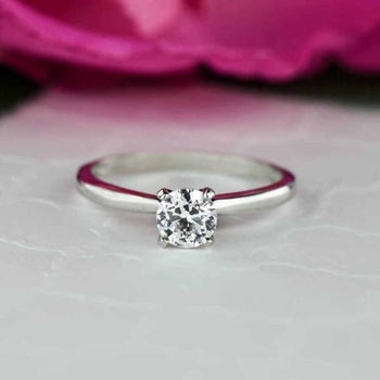 0.5 Carat Round Cut Solitaire Engagement Ring in White Gold over Sterling Silver