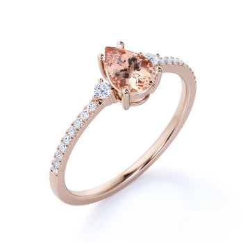 1.5 Carat Three Stone Peach Morganite and Pave Diamond Accents Engagement Ring in Rose Gold