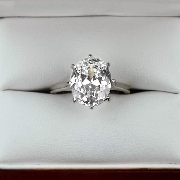 4 Carat Oval Cut Solitaire Engagement Ring in White Gold over Sterling Silver