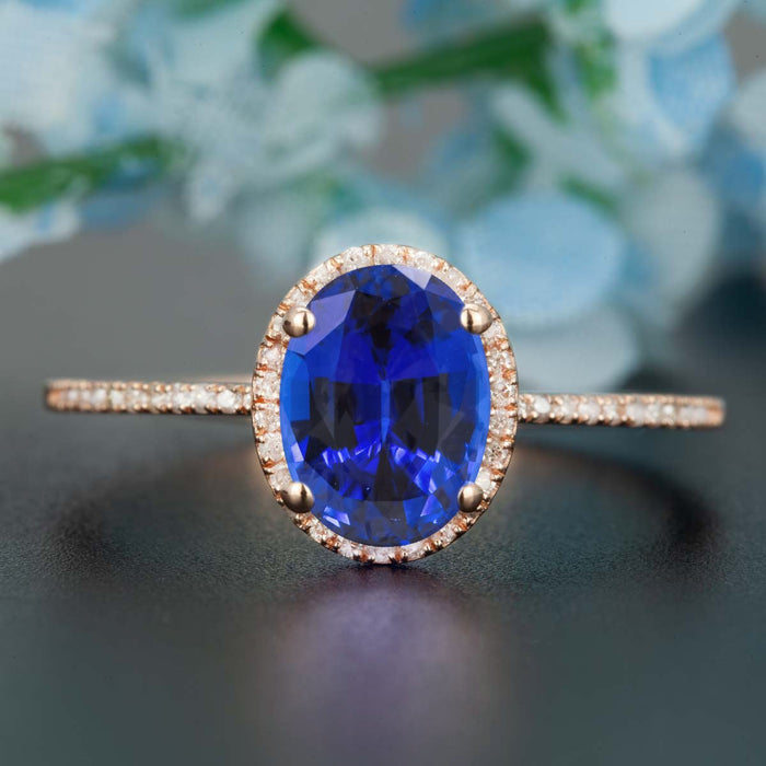 1.25 Carat Oval Cut Sapphire and Diamond Engagement Ring in Rose Gold Dazzling Ring