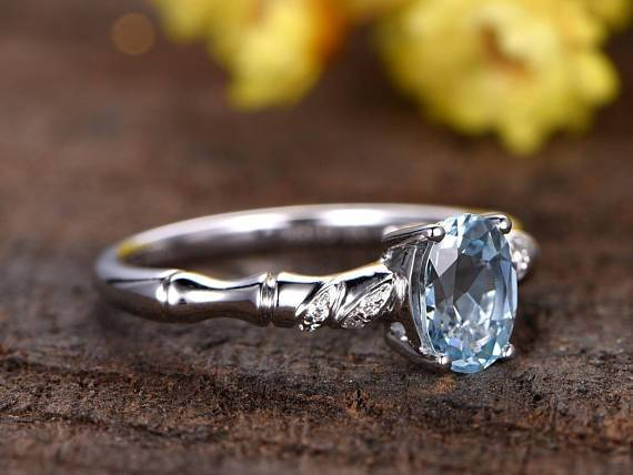 Unique 1.25 Carat Oval Cut Aquamarine and Diamond Engagement Ring in White Gold