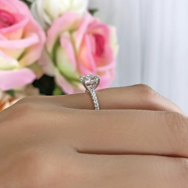 Accented 1.25 Carat Oval Cut Engagement Ring in White Gold over Sterling Silver