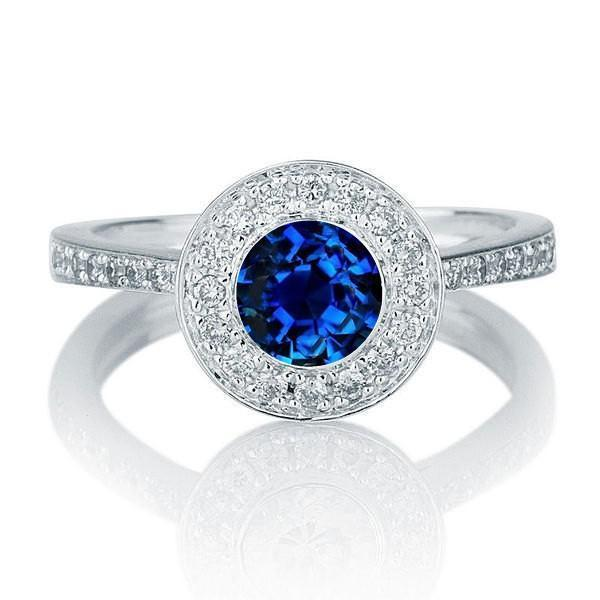 1.25 carat Round Cut Sapphire and Diamond Halo Engagement Ring