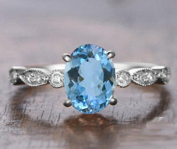 Bestselling 1.25 Carat oval cut Aquamarine and Diamond Engagement Ring in White Gold