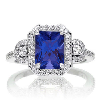 2 Carat Emerald Cut Sapphire and White Diamond Halo Engagement Ring