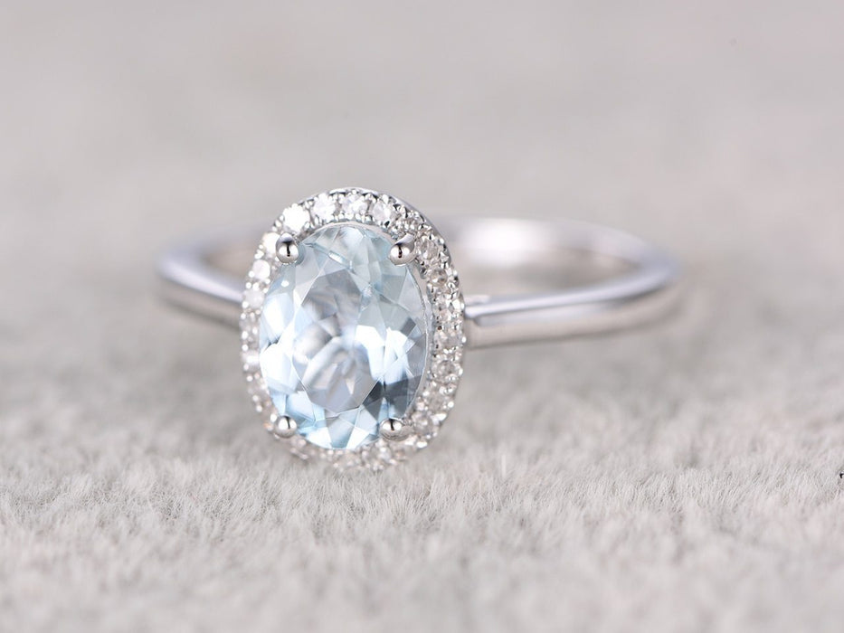Delicate 1.25 Carat Aquamarine and Diamond Halo Engagement Ring in White Gold