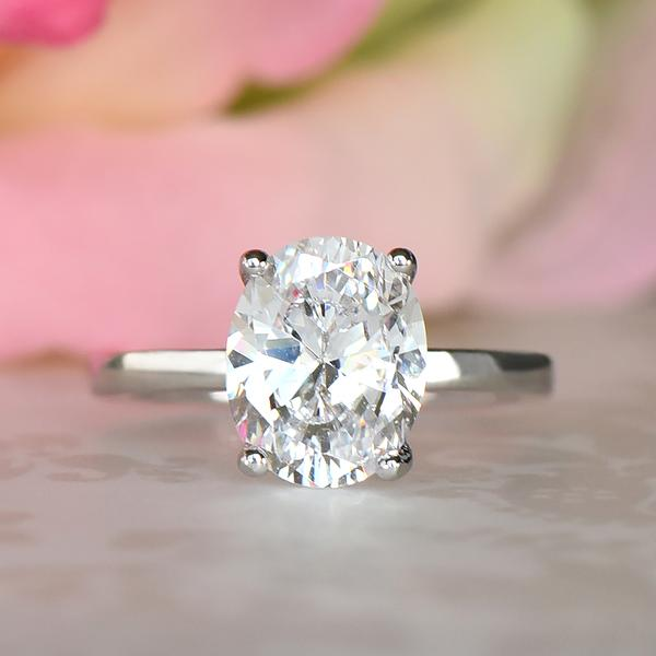 3 Carat Oval Cut Solitaire Engagement Ring in White Gold over Sterling Silver