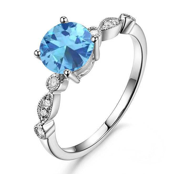 Beautiful 1.25 Carat Round cut Aquammarine and Diamond engagement Ring in White Gold