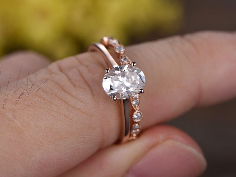Beautiful 1.25 Carat Oval Cut solitaire Moissanite and Diamond Wedding Set in Rose Gold