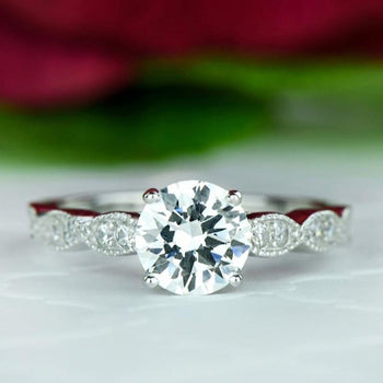 1.25 Carat Round Cut Wide Art Deco Solitaire Engagement Ring in White Gold over Sterling Silver