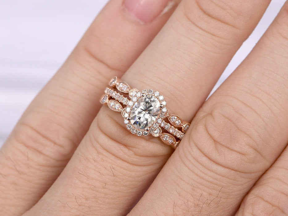 2 Carat Oval Cut Moissanite and Diamond Halo Trio Wedding Ring Set in Rose Gold