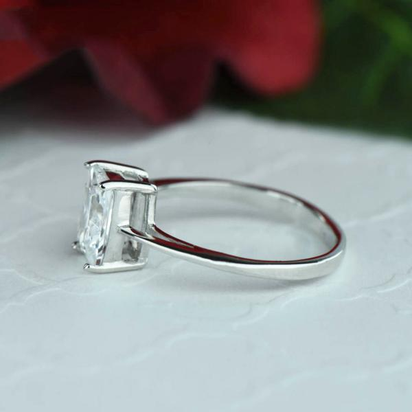 1.5 Carat Emerald Cut Solitaire Engagement Ring in White Gold over Sterling Silver