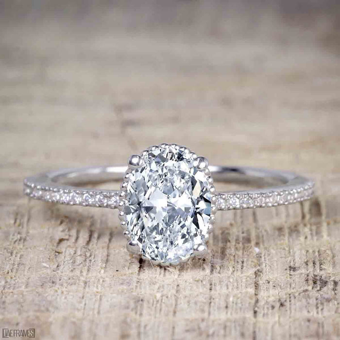 1.25 Carat Oval Cut Moissanite and Diamond Solitaire Engagement Ring in White Gold