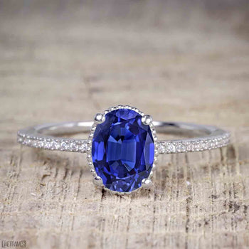 1 Carat Oval Cut Sapphire Solitaire Engagement Ring in White Gold