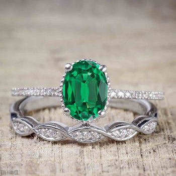 1.25 Carat Oval cut Emerald and Diamond Wedding Ring Set in White Gold