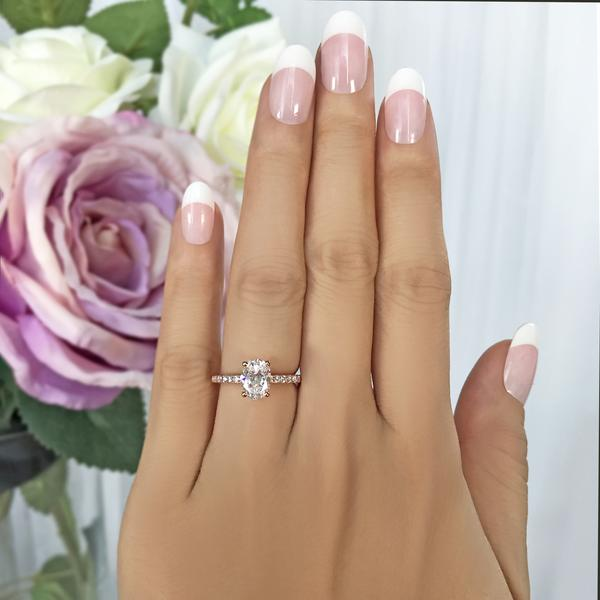 1.25 Carat Oval Cut Accented Engagement Ring in Rose Gold over Sterling Silver