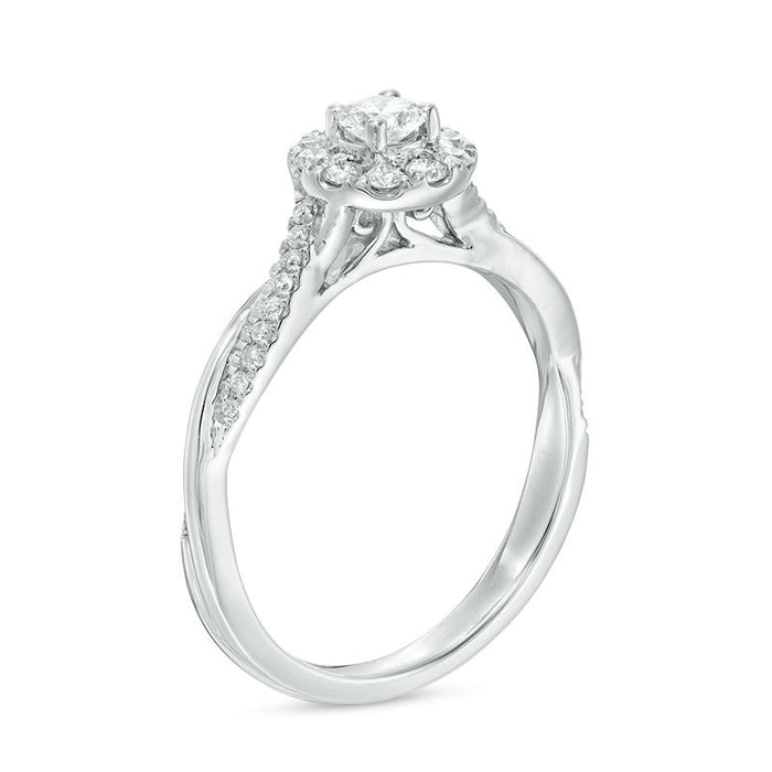 1/2 CT.T.W. Round Cut Diamond Halo Twist Engagement Ring in White Gold