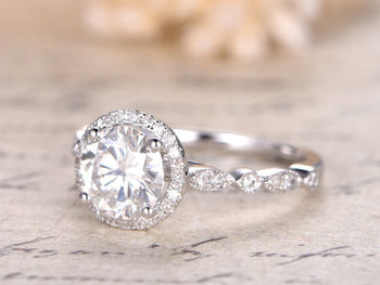 1.50 Carat Round Cut Moissanite and Diamond Halo Engagement Ring in 9k White Gold