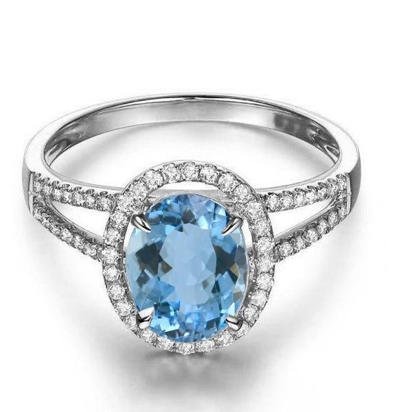 Split shank 1.50 Carat Oval cut Aquamarine and Diamond Halo Engagement Ring in White Gold