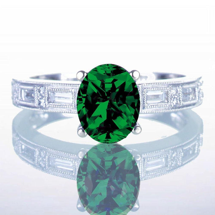 1.5 Carat Oval Cut Emerald and Baguette Diamond Milgrain Engagement Ring