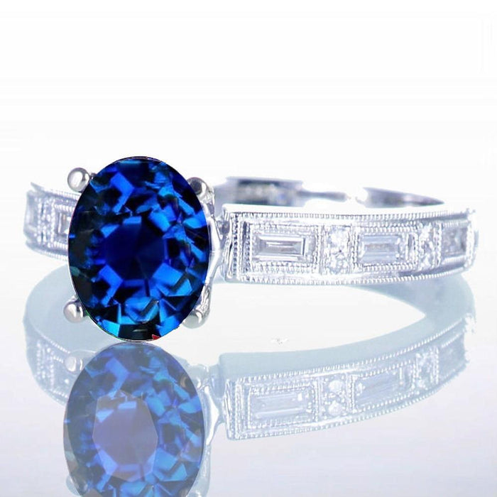 1.5 Carat Oval Cut Sapphire and Baguette Diamond Milgrain Engagement Ring
