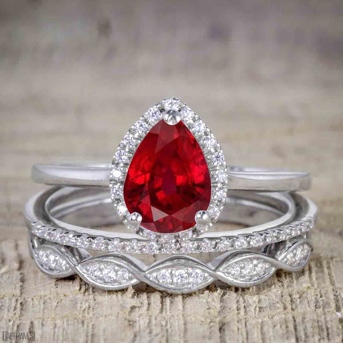 Affordable Antique Artdeco 2.25 Carat Pear Ruby and Diamond Halo Wedding Trio Ring Set in White Gold