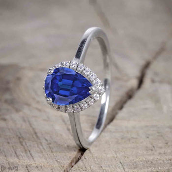 Antique Vintage 1.25 Carat Pear Cut Sapphire and Diamond Halo Engagement Ring for Women in White Gold