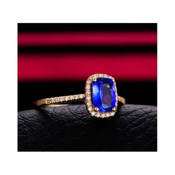 1.50 Carat Oval Cut Blue Sapphire and Diamond Halo Engagement Ring