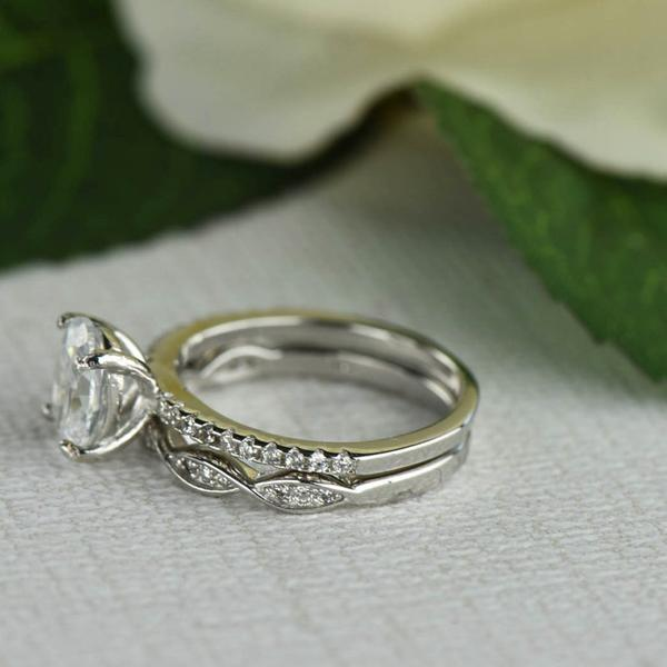 1.5 Carat Oval Cut Swirl Bridal Ring Set in White Gold over Sterling Silver