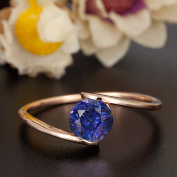 1.25 Carat Round Cut Sapphire and Diamond Engagement Ring in Rose Gold Glamorous Ring