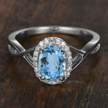 Lovely 1.25 Carat Aquamarine and Diamond Oval Cut Halo Engagement Ring in White Gold