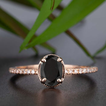 Elegant 1.25 Carat Oval Cut Black Diamond and Diamond Engagement Ring in Rose Gold
