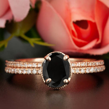 Elegant 1.50 Carat Oval Cut Black Diamond and Diamond Wedding Ring Set in Rose Gold