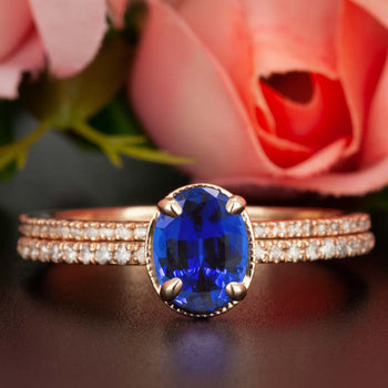 Elegant 1.50 Carat Oval Cut Sapphire and Diamond Wedding Ring Set in Rose Gold
