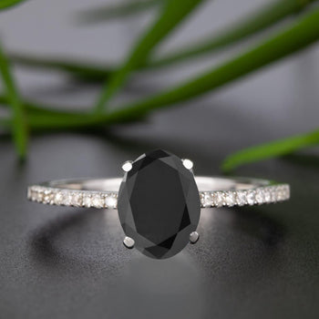 Flawless 1.25 Carat Oval Cut Black Diamond and Diamond Engagement Ring in White Gold