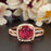 1.5 Carat Cushion Cut Halo Ruby and Diamond Wedding Ring Set in 9k Rose Gold