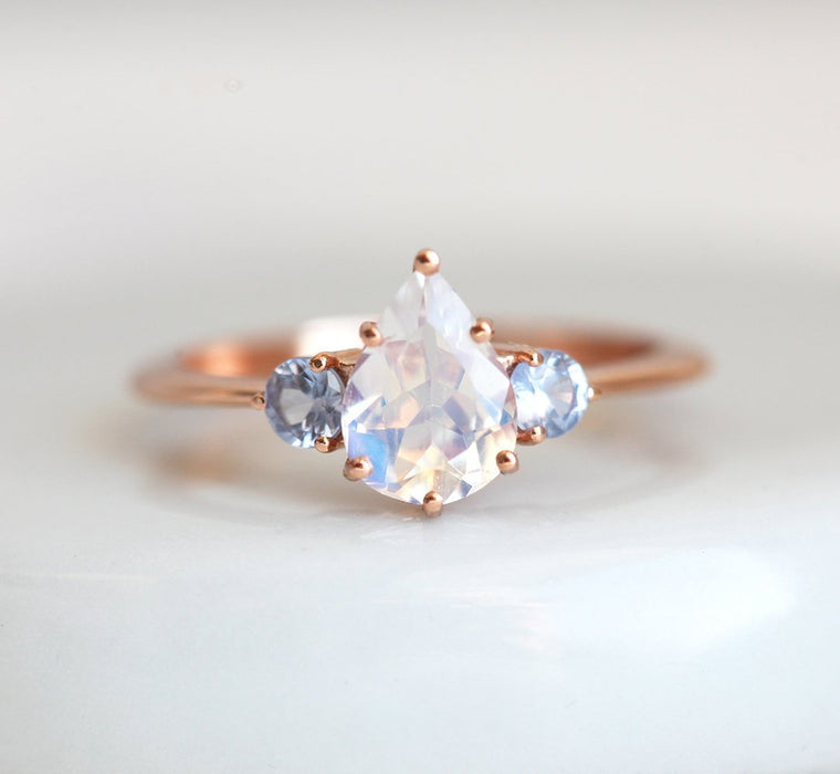 1.10 Carat Pear Shape Rainbow Moonstone and Sapphire Three Stone Engagement Ring in Rose Gold