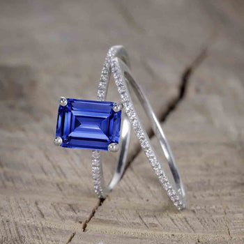 Unique 1.25 Carat Emerald Cut Sapphire and Diamond Bridal Ring Set in White Gold