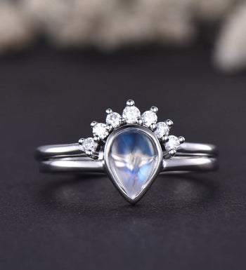 Bezel 1.25 Carat Pear Shape Blue Moonstone and Diamond Wedding Set with Crown Band in White Gold