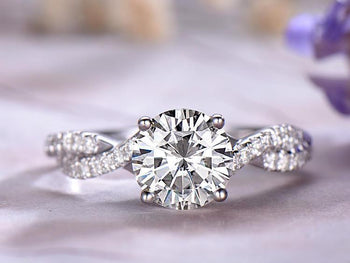 1.25 Carat Infinity Round Cut Moissanite and Diamond Engagement Ring in 9k White Gold
