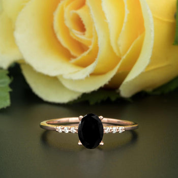 1.25 Carat Oval Cut Black Diamond and Diamond Engagement Ring in Rose Gold Elegant Ring