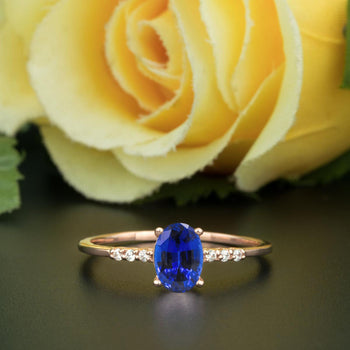 1.25 Carat Oval Cut Sapphire and Diamond Engagement Ring in Rose Gold Elegant Ring
