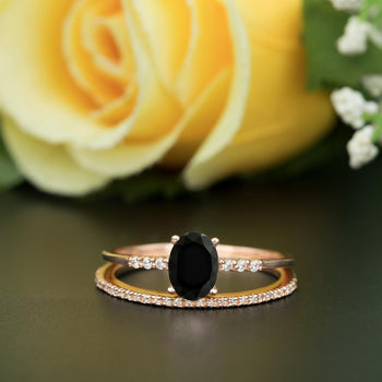 1.5 Carat Oval Cut Black Diamond and Diamond Wedding Ring Set in 9k White Gold Elegant Ring