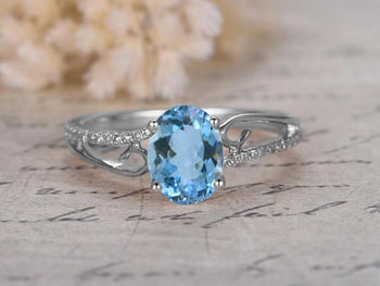Marvellous 1.25 Carat Oval Cut Aquamarine and Diamond Engagement Ring in White Gold