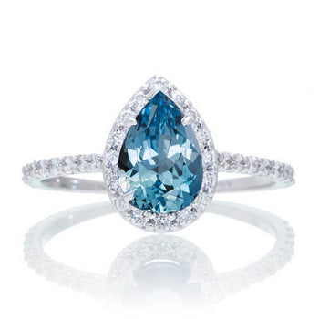 Elegant 1.50 Carat Pear Cut Aquamarine and Diamond Halo Engagement Ring in White Gold