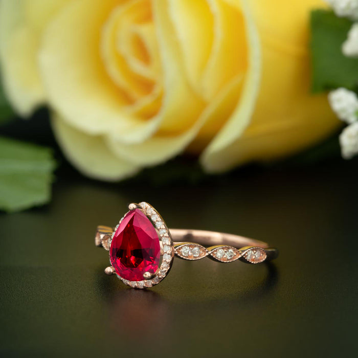 1.25 Carat Pear Cut Halo Ruby and Diamond Engagement Ring in 9k Rose Gold Vintage Ring