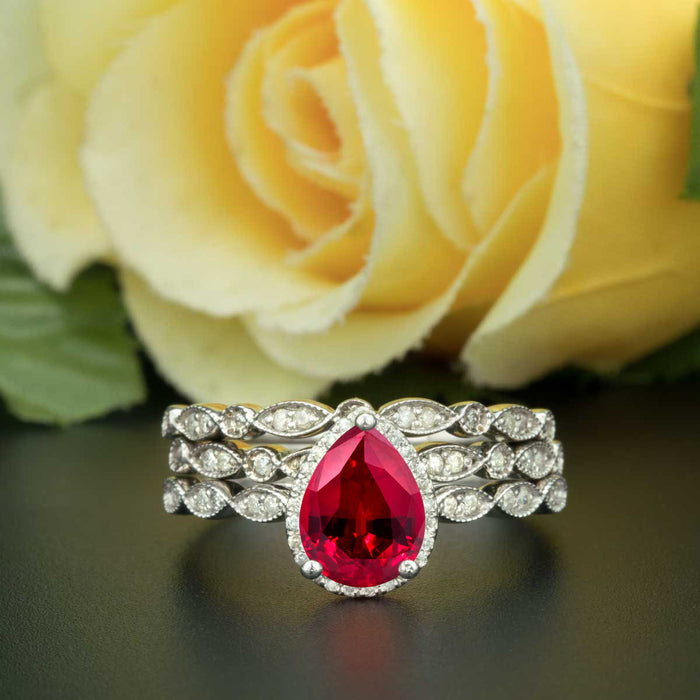 2 Carat Pear Cut Halo Ruby and Diamond Trio Wedding Ring Set in 9k White Gold Vintage Ring