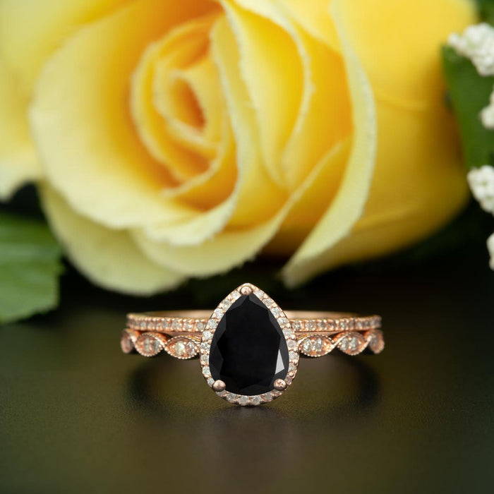 1.5 Carat Pear Cut Halo Black Diamond and Diamond Ring with Classic Wedding Band in 9k Rose Gold